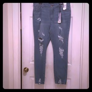 Ripped blue spice blue jeans